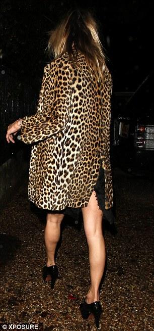 Glam rocker: The model wore her trademark leopard print coat to enjoy her birthday on Thursday night