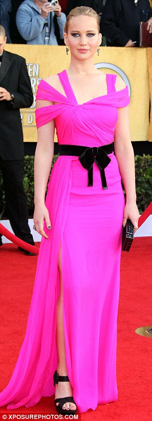 Style stealer: The bright pink Oscar de la Renta gown Amy Adams (left) wore to Thursday's Critics' Choice Movie Awards drew comparison to American Hustle co-star Jennifer Lawrence's neon pink Roland Mouret frock worn to the 2011 SAG awards