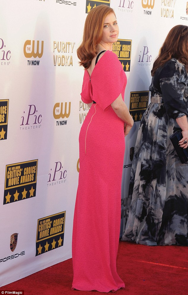 Picture-perfect: The star, who took home the award for Best Actress In A Comedy for American Hustle, wore her signature red tresses down over one shoulder in a sleek style with curled ends and kept her make-up fresh and natural