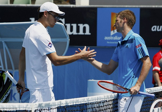 Looking shady: Florian Mayer (right) shakes hands with Jerzy Janowicz after winning in straight sets