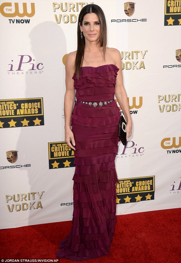 Scarlet beauty: The Oscar-nominee was ravishing in her deep red column-style strapless Lanvin gown, which featured layered ruffles and an ornate silver belt, which she teamed with Jimmy Choos, a Roger Vivier clutch and Fred Leighton earrings