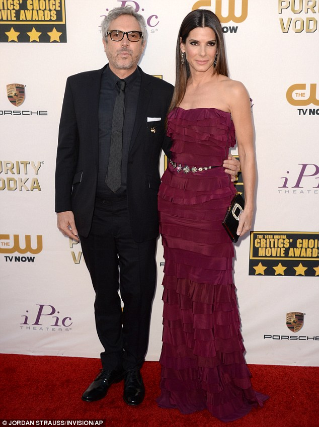 A winning combination: It proved to be quite the night for Sandra and her Gravity writer and director Alfonso Cuarón, who scooped a total of seven gongs for the sci-fi drama - including Best Director, Best Cinematography and Best Visual Effects
