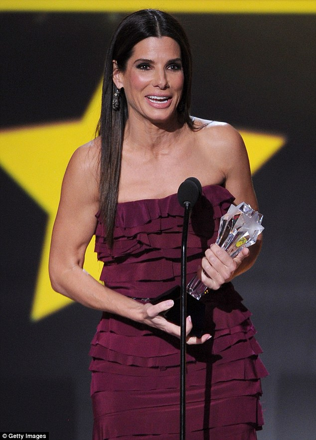 Caught off-guard: Sandra Bullock dropped the F-bomb after her acceptance speech for Best Actress In An Action Movie for Gravity was rudely interrupted during Thursday night's Critics' Choice Movie Awards
