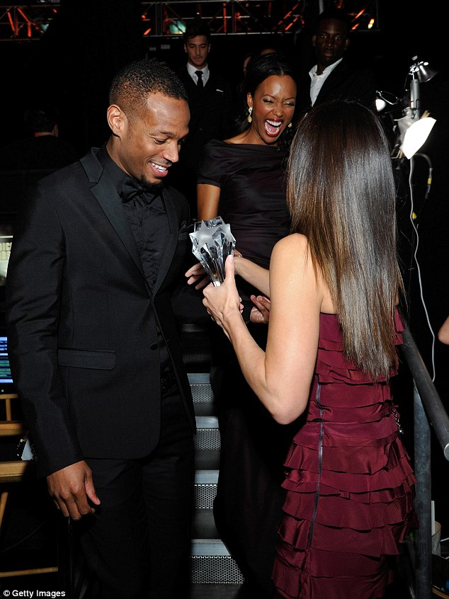 All's well that ends well: The star shared a laugh backstage with Marlon and the evening's host, Aisha Tyler, following the awkward malfunction, which appeared to have everyone in fits of laughter