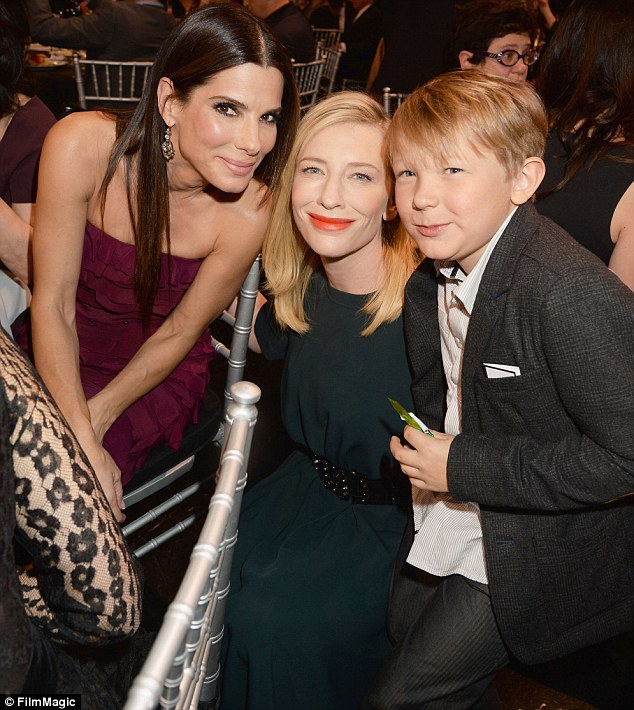 Famous friends: Sandra, Kate and Ignatius flashed their smiles