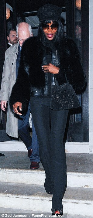 '70s style: Naomi wore a furry jacket with flared trousers for the birthday party