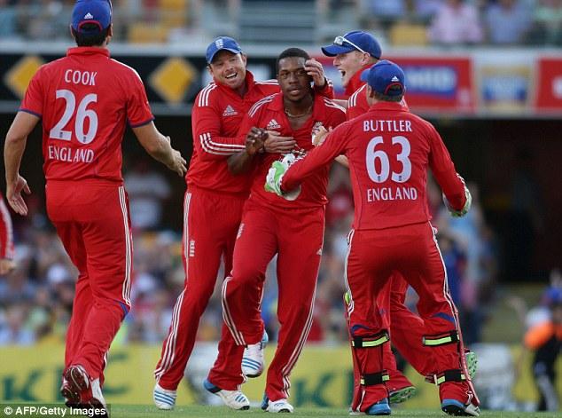 Mobbed: Jordan's England team-mates rush to congratulate him on the stunning effort