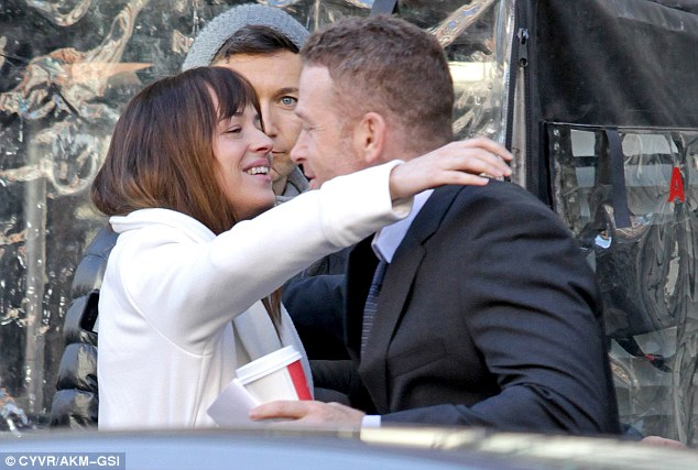 Warm reception: Dakota was seen giving Max a hug as clutched onto a warm drink