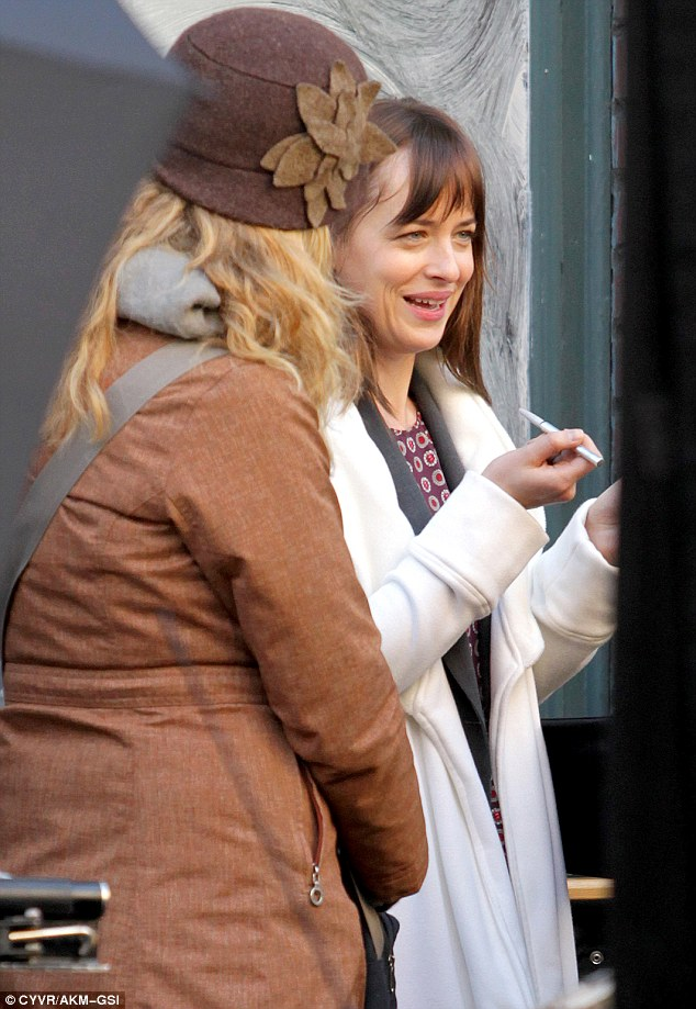 Natural beauty: The star also got her natural-looking make-up reapplied in between takes before ditching the coat