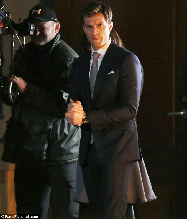 The gaze: Jamie was seen rubbing his hands together as he took a break from filming