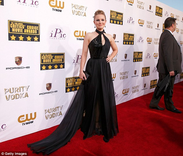 Lengthy: Kristen looked simply stunning in her long, black flowing gown