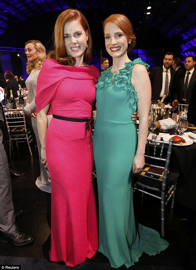 Seeing red, pink and green: Fellow red head Amy Adams (left) was also praised for her elegant pink gown and posed alongside Jessica (right) who was dressed in flattering green
