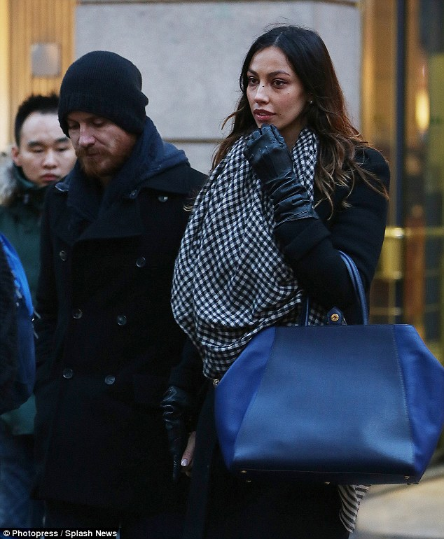 Happy couple: The 25-year-old added a splash of colour to her outfit with a giant blue handbag and monochrome scarf