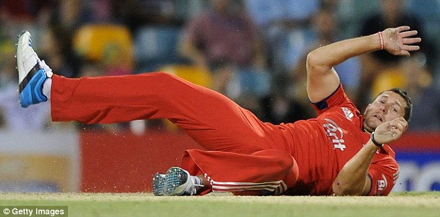 How low can you go? Tim Bresnan of England falls to the turf as England crash to ANOTHER defeat on their embarrassing tour of Australia - this time losing the second ODI by one wicket in Brisbane