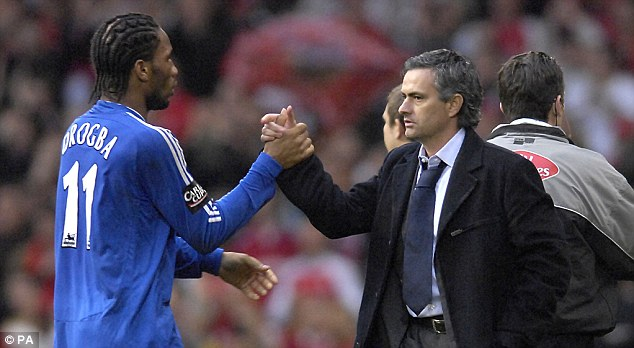 Happy memories: Drogba and Jose Mourinho - in his first Stamford Bridge spell - during their successful Chelsea days