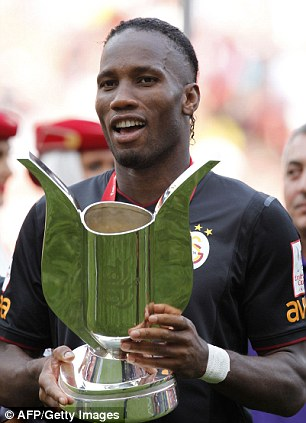 Drogba with the Emirates trophy in the summer of 2013