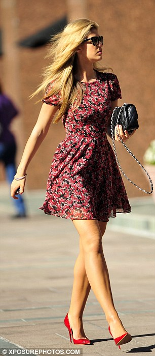California girl: Amy looked stunning and carried a pair of floral sunglasses and a Chanel handbag with her