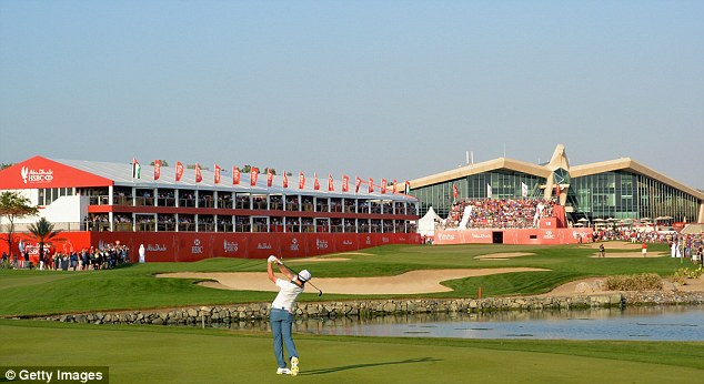 Magnificent: McIlroy launches his three-wood approach on the par five 18th hole at Abu Dhabi Golf Club