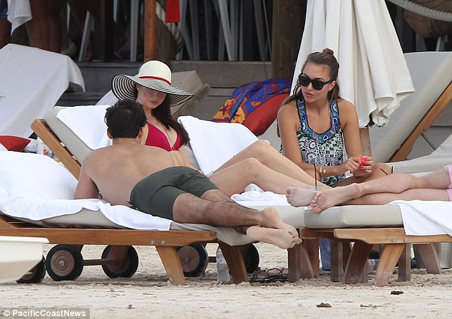 Scarlet woman: The striking British model, who has been in St. Barts on a photoshoot since the new year, looked every inch the glamour puss in a plunging red bikini