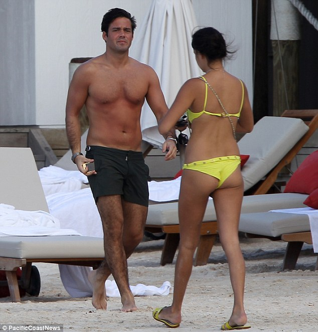 Little Miss Sunshine: Another girl in a bright yellow bikini seemed to catch Spencer's eye as he strutted down the beach