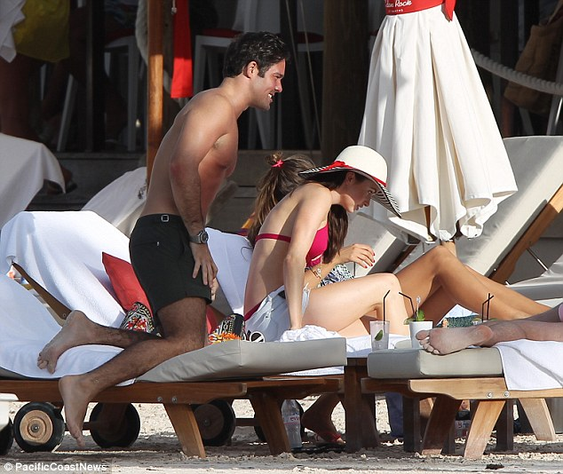 Going in for the kill: Emma and Spencer were first spotted together earlier this week when they were seen cuddling and kissing on a sun lounger as they hit the beach