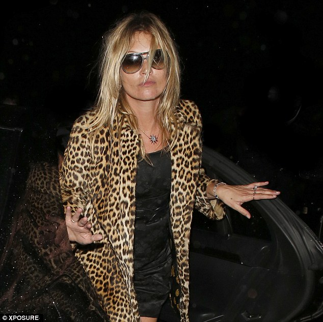 Eat, sleep, rave, repeat: Kate Moss arriving at her London home on Friday morning following her 40th birthday celebrations
