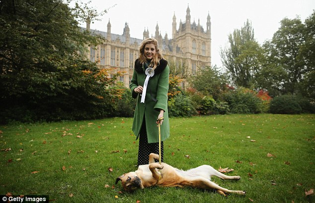 Dog days: The MP entered her Labrador cross Penny Lane in the Westminster Dog of the Year contest. Sadly she lost out to Dover's Charlie Elphicke - but she could have better luck on the cheesy TV show Splash!