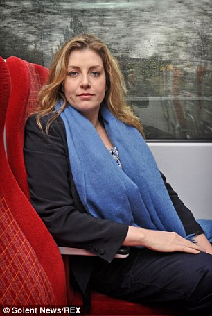 Diver in training: More austere activities taking up the MP's time include the size of train seats