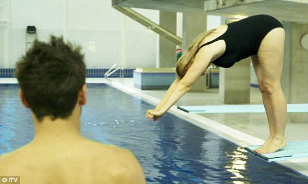 Practice makes perfect: Olympian Tom Daley watches the Conservative MP perfecting her technique