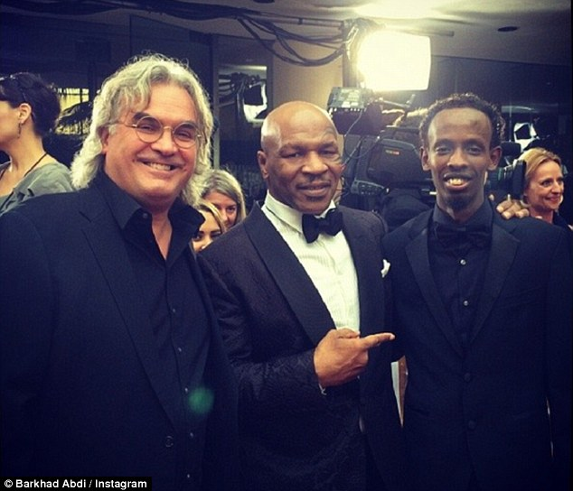 Friends in high places: Acting novice Barkhad Abdi has posted photos of him at the Golden Globes at the weekend, alongside boxing champ Mike Tyson and Captain Phillips director Paul Greengrass