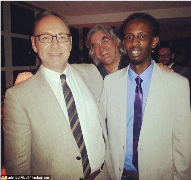 New pals: Barkhad Abdi poses with House of Cards star and Oscar winner Kevin Spacey - while director Paul Greengrass looks on