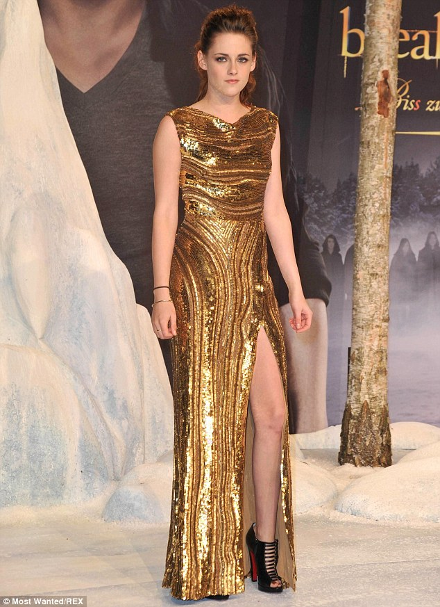 As she was: An awkward Kristen all dolled up at a Twilight premiere
