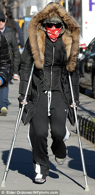 Not expressing herself: It was unclear to read what mood Madonna was in on Friday, as she hobbled around in disguise