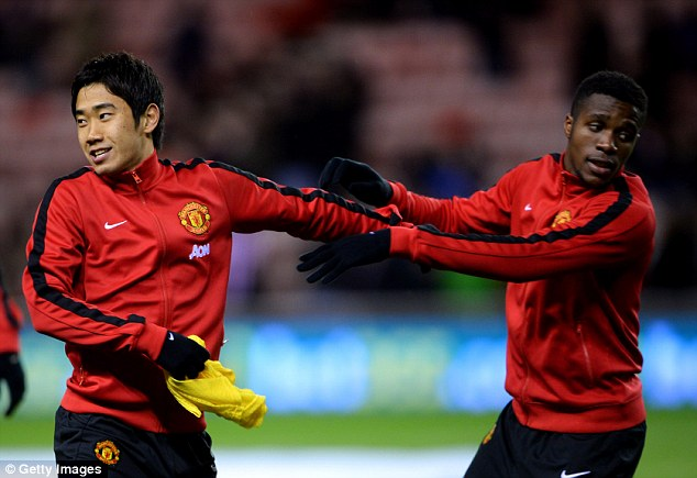 Bench mark: Zaha, pictured with Shinji Kagawa (left), has not started a league game under Moyes