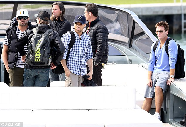 Arriving in style: Adrian arrived on a large boat with (from far right) co-stars Kevin Connolly, Kevin Dillon and Jerry Ferrera