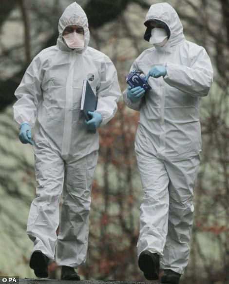 People in forensics suits attend the scene near Kirkcaldy