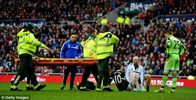 Anxious moments: Ramirez receives treatment before leaving the pitch