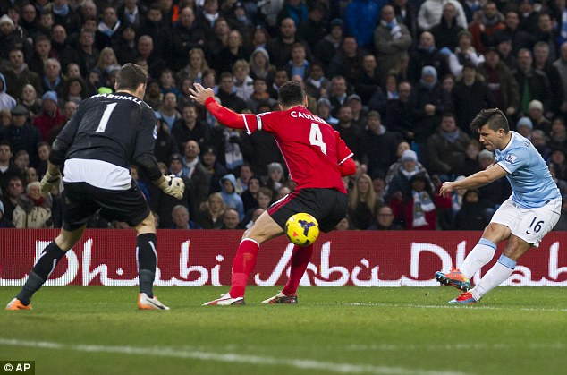 Job done: Substitute Sergio Aguero shoots past Steven Caulker and David Marshall to make sure of the win