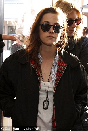 Cool operator: Kristen donned retro black shades later in the day
