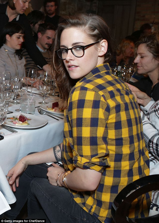 Changing it up: The star was later seen wearing a yellow plaid shirt as she attended a Bravo Top Chef dinner