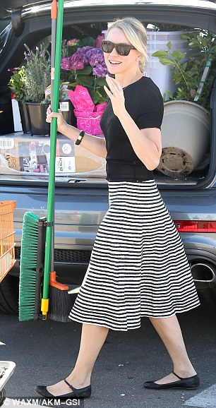 Green fingers: Naomi Watts was shopping for flowers and landscaping products in a black T-shirt and monochrome skirt
