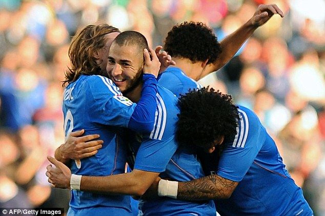 Karim Benzema celebrates scoring Madrid's third goal with teammates