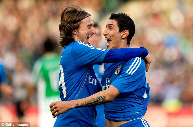 Outstanding: Di Maria celebrates with Luka Modric, who enjoyed another excellent performance at Estadio Benito Villamarin