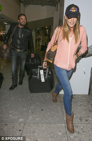 Let's go: Jamie and Chloe look relaxed and happy following their sunshine break in Los Angeles