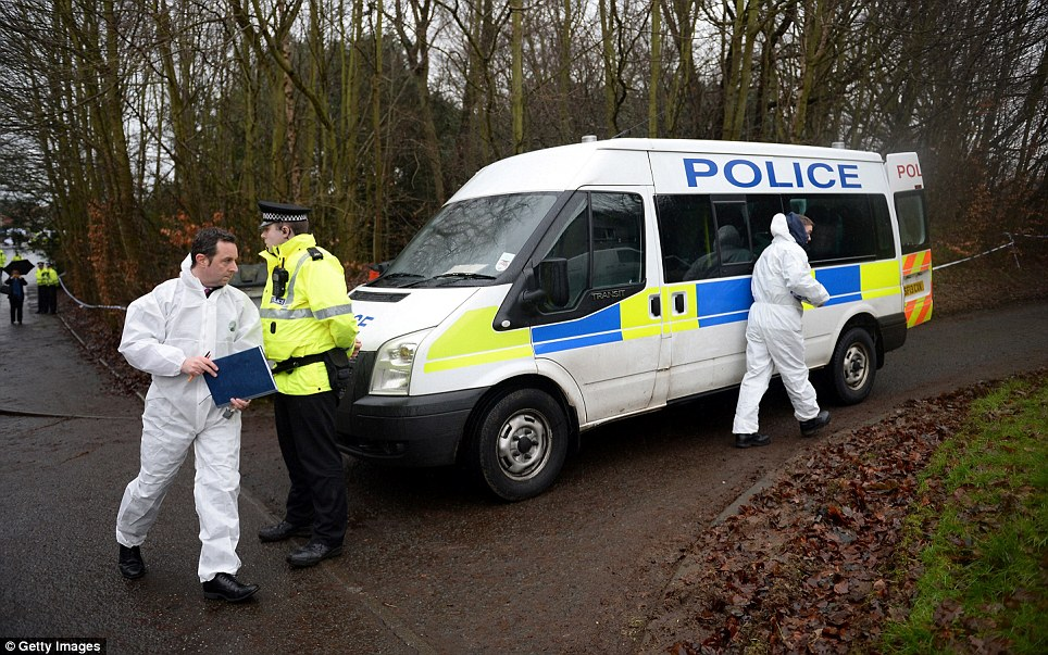 Forensic officers arrive in a police van at the woodlands scene in Fife on Saturday afternoon