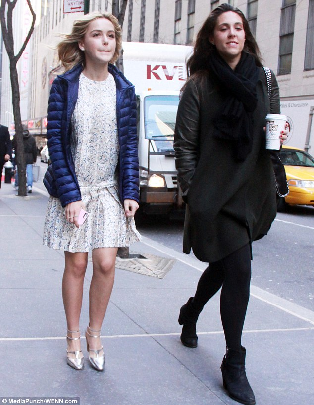 Out for a stroll: Later, Kiernan was spotted wearing a similar dress with a different pattern with a friend in NYC
