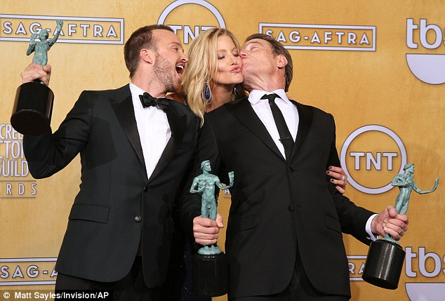 Lovefest! Aaron Paul - who played charismatic Jesse Pinkman - got close to a cheek-smooching Anna and Bryan