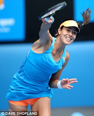 Strain: Ivanovic powers down a serve during the match