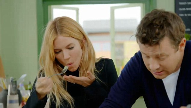 Tasty treat: After describing the recipe as 'seriously good', Sienna offered a fork-full to Jamie who willingly obliged