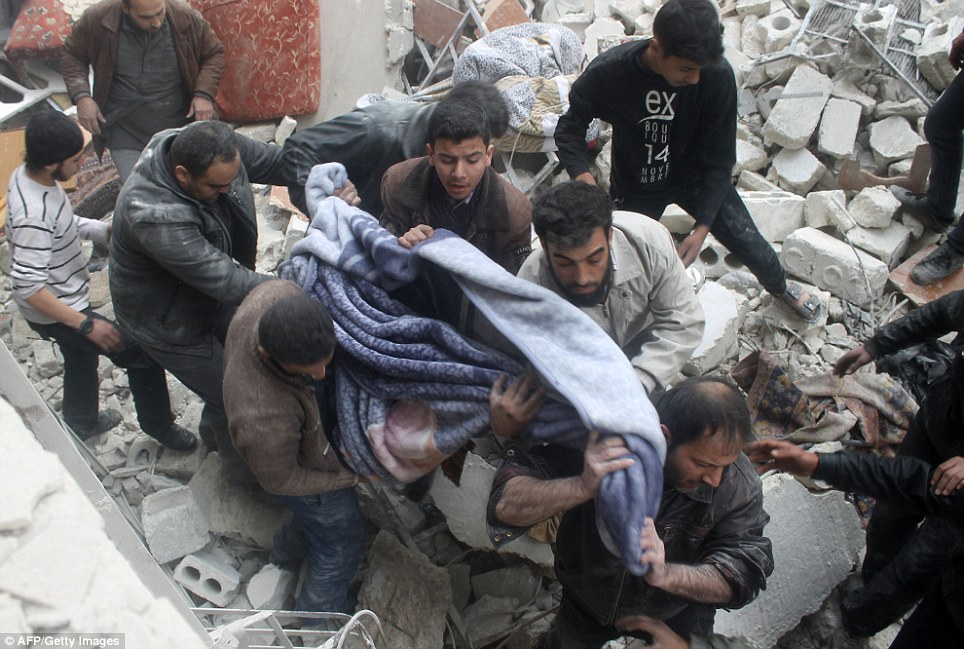 Casualties: A body is extracted from rubble in Aleppo as people search for survivors after a building collapsed  during an airstrike on the northern Syrian city